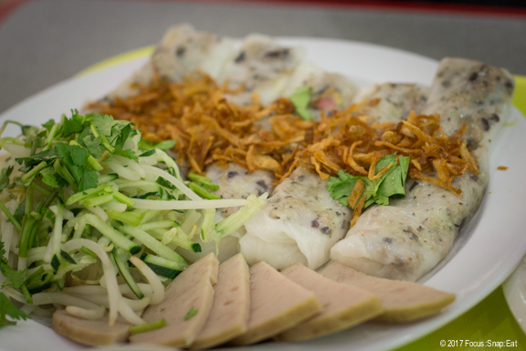 Banh Cuon, or flat rice noodle rolls, are served with a side of Vietnamese deli meats.