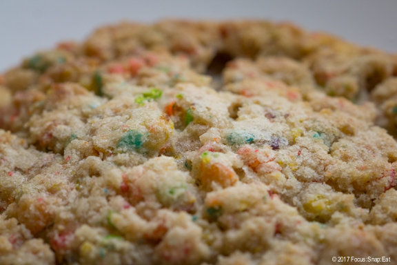 Close up of a cookie made with Fruity Pebbles cereal.